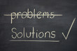 problems - solutions written on a blackboard with solutions tick