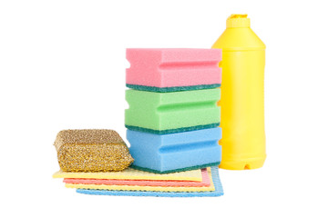 Bottle, colorful sponges isolated on white