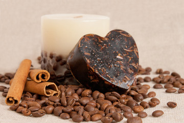 aroma handmade soap and candle with cinnamon sticks and coffee b