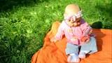 Happy little baby girl play outdoor