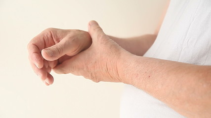 a man suffering from pain in his thumb