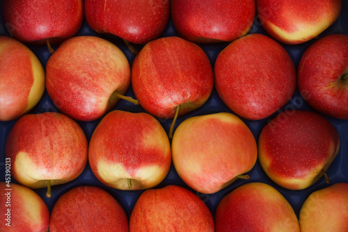 Lovely red apples packed neatly together perfect as a background