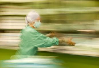 Blurred nurse runing busy working