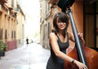Woman playing double bass on the street