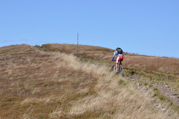 A man riding uphill on a mountain bike