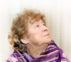 portrait of elderly happy woman dreaming