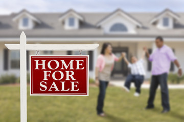 Real Estate Sign and Hispanic Family in Front of House