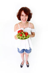Young woman with fruits on a dish