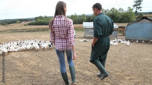Couple of duck breeders walking outdoors