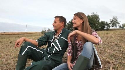Couple of farmers sitting in field