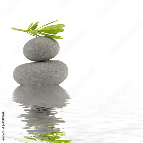 Balancing stones with leaves reflection