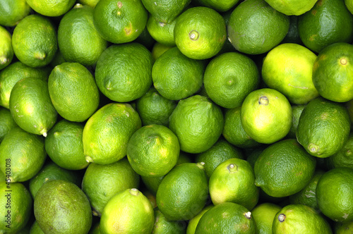 Fresh and green lemons background