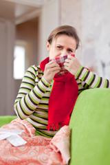 sick woman uses handkerchief