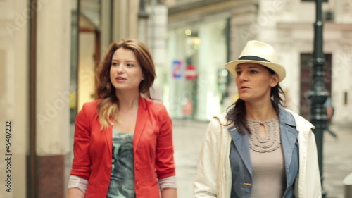 Young women looking at shop exhibition with shoes, steadycam sho