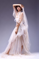Beauty fashion woman in retro vintage white classic dress