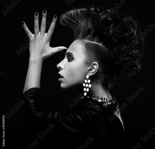 Strange stylish punk woman saluting and gesturing