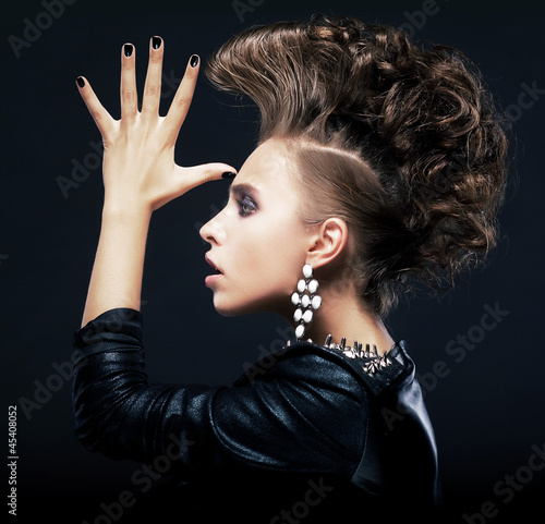 Beauty woman with pigtails, creative hairstyle, saluting