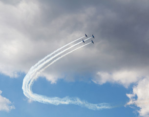 Planes flying in blue cloudy sky