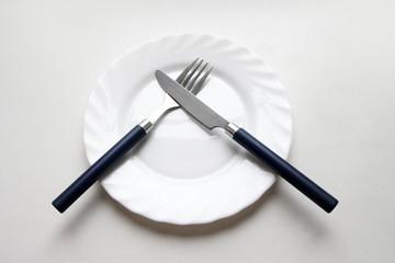 scene white plate on light background as utensil