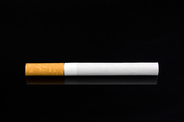 A cigarette against a dark background.