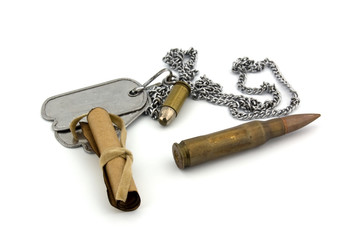 Bullets, dogtag and a parchment letter isolated on a white backg
