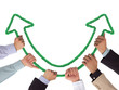 Hands holding green arrows pointing upwards