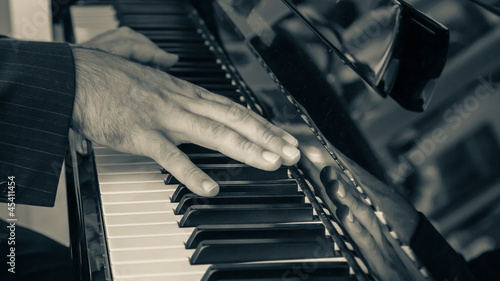 Detail of Hand playing Piano