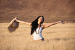 Young beautiful woman in a wheat field with white dress