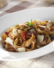 Whole wheat noodles with olives and grilled vegetable