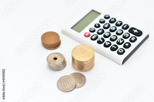 電卓と硬貨