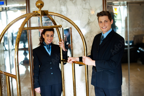 Concierges holding the cart and posing - 45416892
