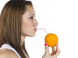 profile view of a teenage girl drinking orange