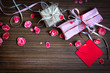 Present,gift bow with petal from flowers on wooden table