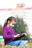 Little Girl holding tablet digital computer
