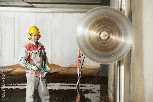 builder worker operating demolition machine - 45426471