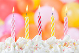 Five Birthday candles on colorful balloons background