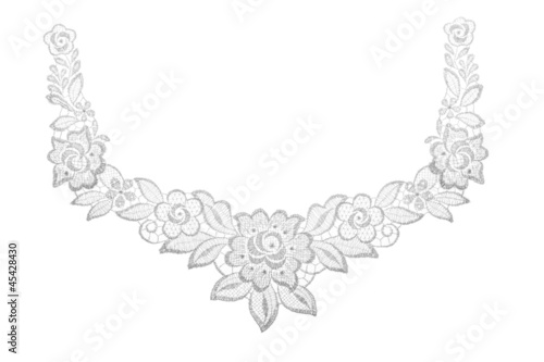 Embroidered lace trim over white. Fabric texture.