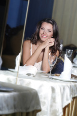 portrait of young happy beautiful woman in restaurant
