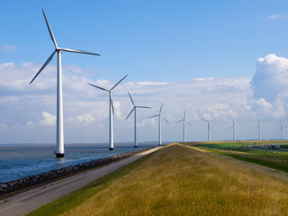 Row of windturbines along motorway