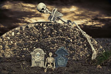 skeleton on cemetery wall