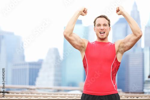 Winning athlete man celebrating