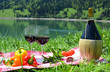 Wine and vegetables served at a picnic. Switzerland