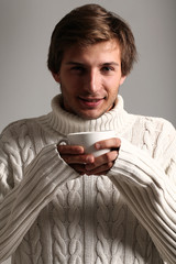 Young and handsome man with cup of coffee
