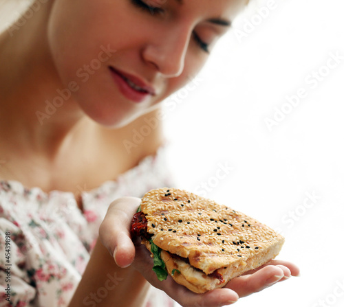 Woman holding fresh sandwich