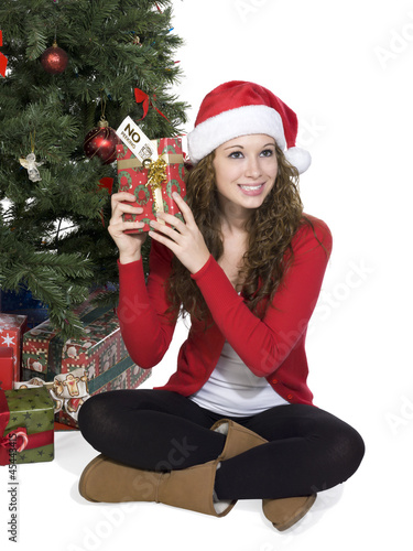 woman wearing a santa costume holding a gift