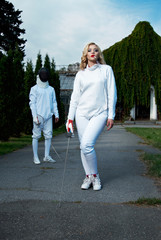 young couple in fencing costumes