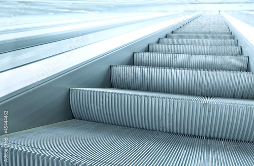 blue escalator in motion