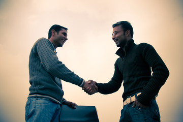 Shaking hand of indian young happy people