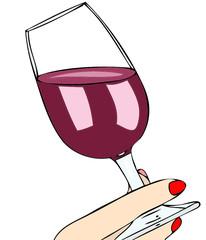 Mano femminile con un bicchiere di vino