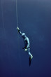 Freediver raises from the depth by rope